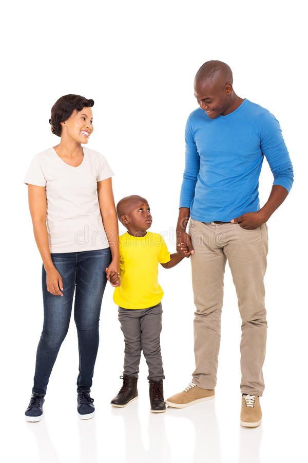 Black couple little son. Smiling young black couple with their little son on white background stock images