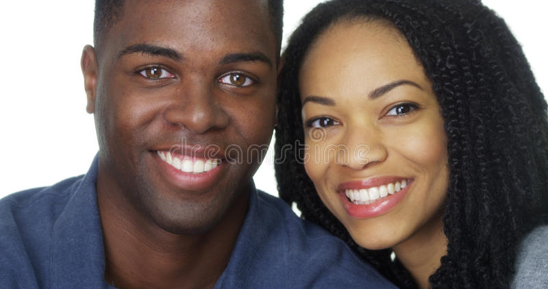 Black couple smiling and looking at camera royalty free stock photos
