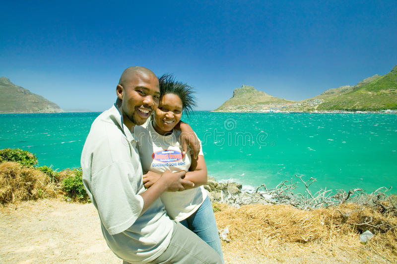 Black couple on a visit to Hout Bay, Southern Cape Peninsula, outside of Cape Town, South Africa royalty free stock images