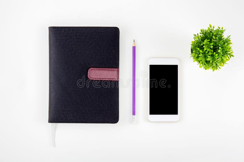 Black cover leather notebook or diary for reminder and memo isolated on white background royalty free stock image
