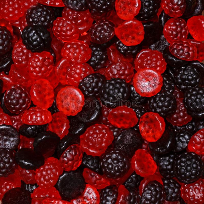 Black and cranberry candies in the form of raspberries and blackberries royalty free stock image