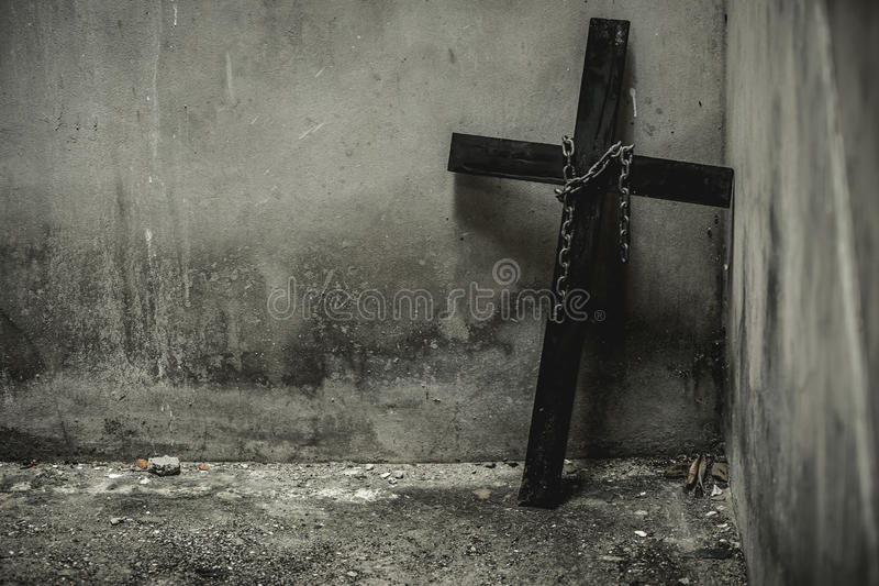 Black cross. With a looped chain. And being placed in isolation in the basement of the old. But fear and loneliness. Halloween Accessories royalty free stock image