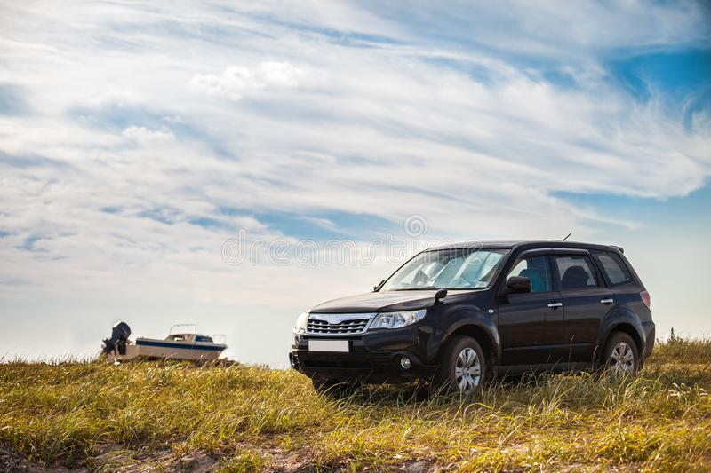 Black crossover at sea coast. In summer stock images