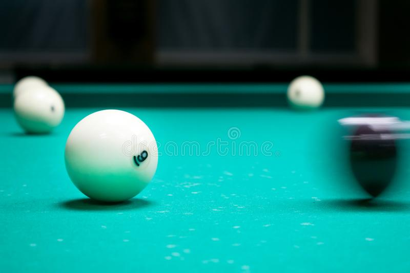 Black cue ball striking white balls with number 6. Russian pyramid (Russian billiard, pyramid billiards), cue sport. royalty free stock images