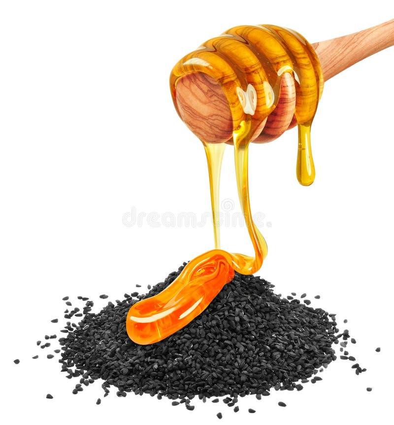 Black cumin and honey royalty free stock photo