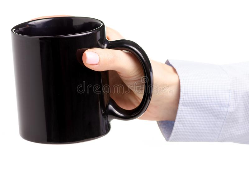 Black cup mug in female hand royalty free stock image