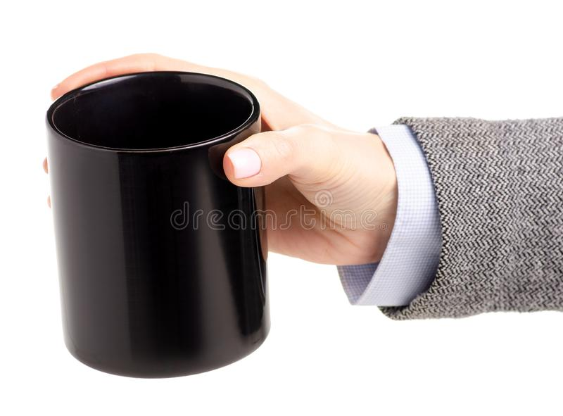 Black cup mug in female hand royalty free stock photos