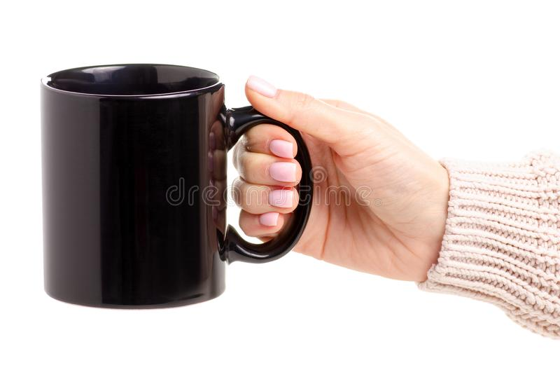 Black cup mug in female hand royalty free stock photography
