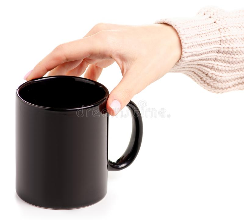 Black cup mug in female hand stock image
