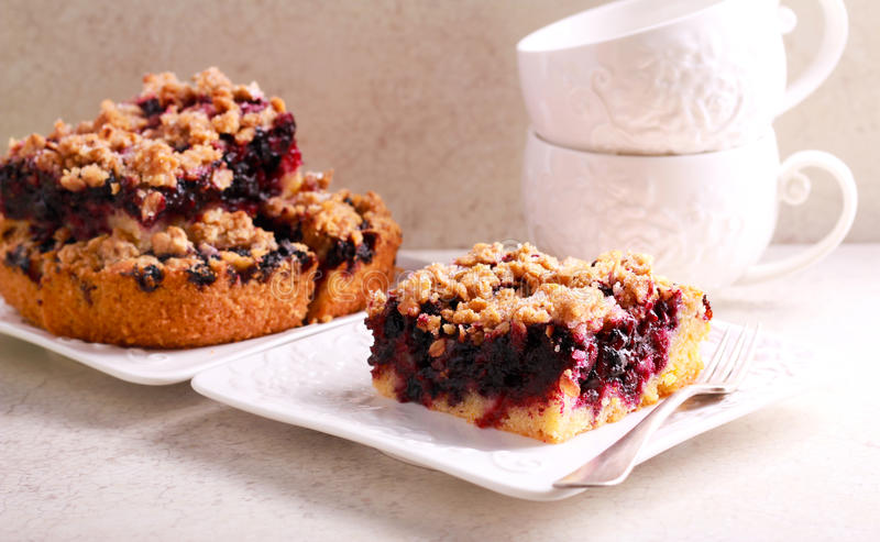 Black currant and blueberry crumble slice bar stock photography
