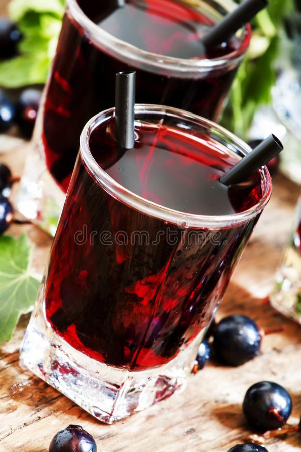 Black currant cocktail with berries, selective focus royalty free stock photography