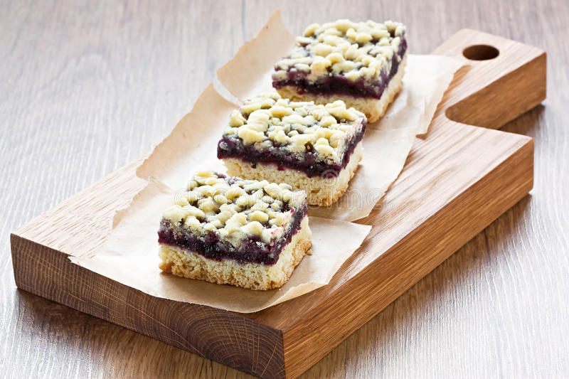 Black currant crumble pie bars. Homemade black currant crumble pie bars delicious sweet dessert royalty free stock image