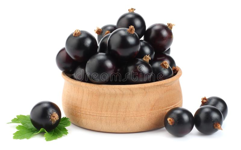 black currant in wooden bowl with green leaf isolated on white background stock images