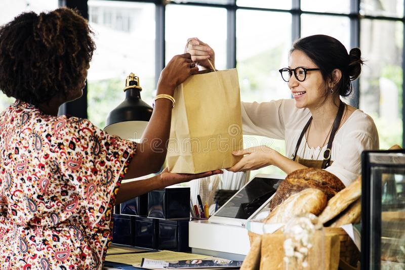 Black customer buying bakery products stock images