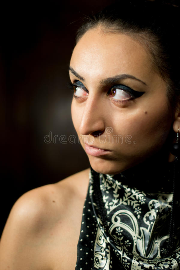 Black / dark fashion session - woman looking left.  royalty free stock photo
