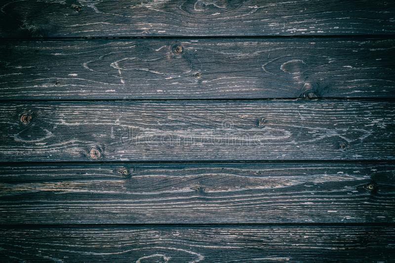 Black dark gray colored wood background. Rustic grunge abstract wooden background or texture. stock image