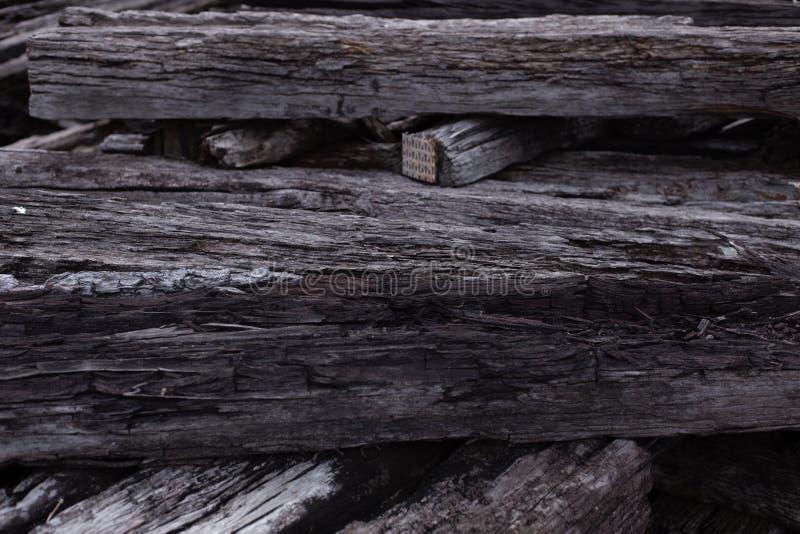 Black dark old crack wood log railway sleepers high detail macro. Black dark old crack wood log railway sleepers weathered dim light tone high detail nature stock image