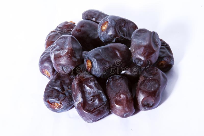 Black dates which are good source of iron. Semi-dry dates which the good source of carbohydrates on white royalty free stock photography
