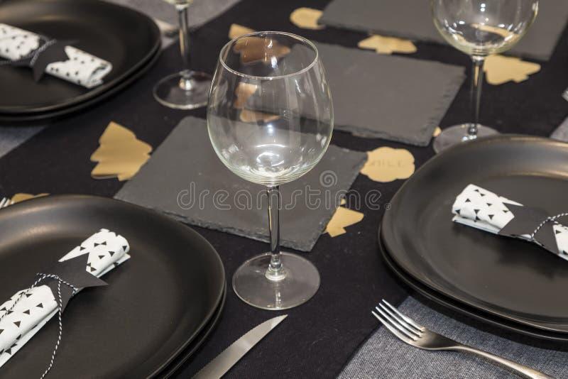 Black decoration napkin star shaped food table royalty free stock photo