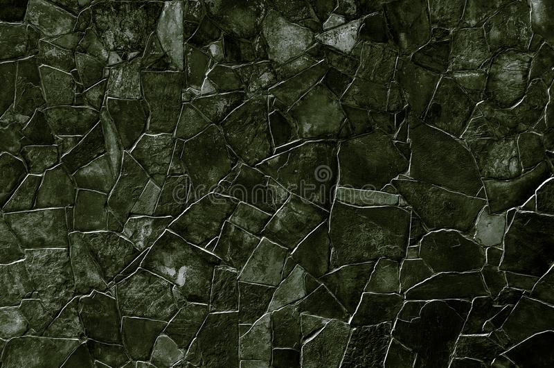 Black stone wall. Black decorative stone wall for texture, background, text or image royalty free stock image