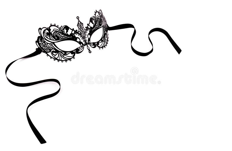 Black delicate lace mask on a white background. Black metal carnival mask. stock images
