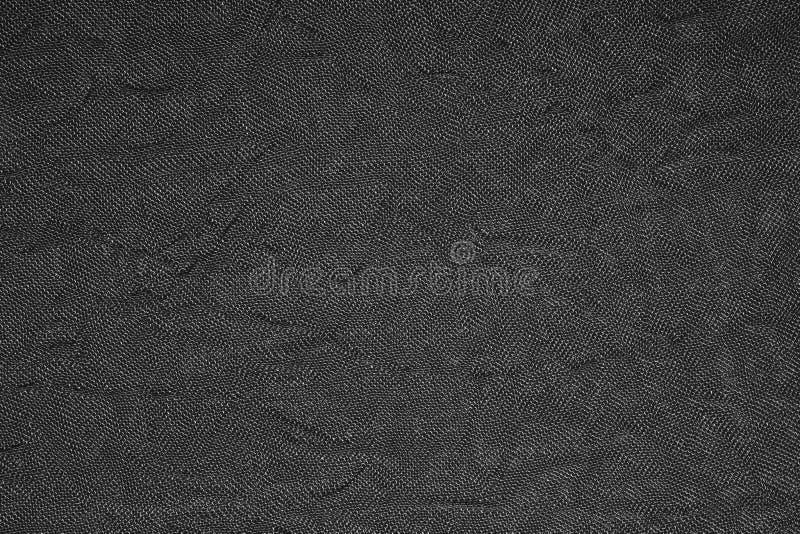 Black dense woven fabric texture. stock photo