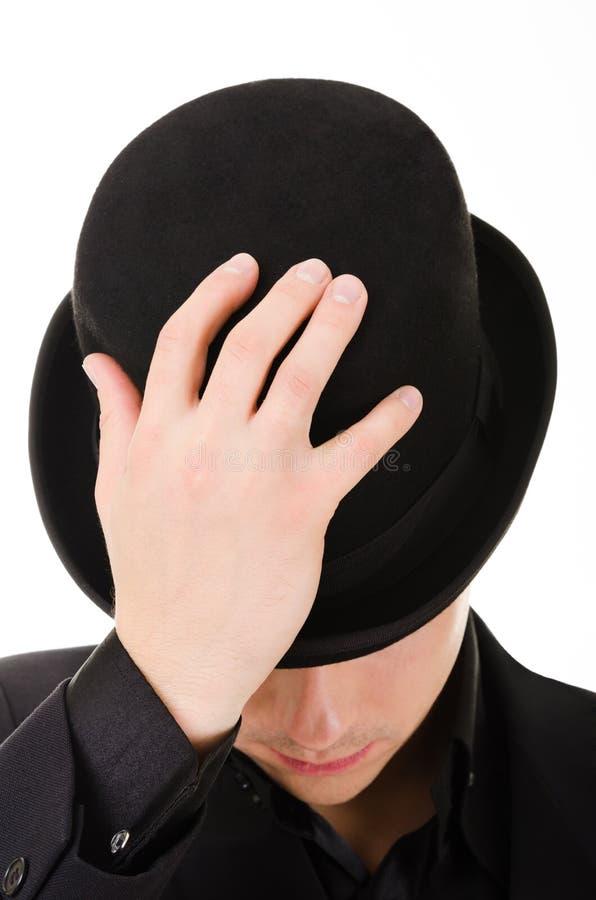 Retro stylish man in black hat stock image