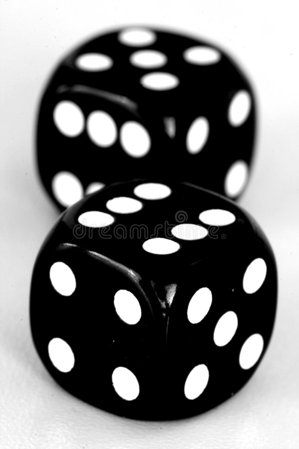 Black dice close up. Close up of two black dice royalty free stock photography