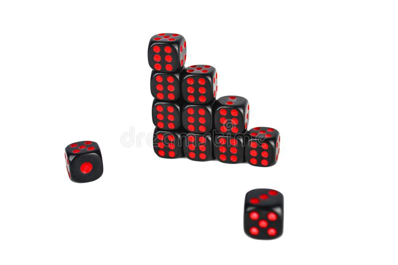 Black dice with red numbers isolated on white background royalty free stock photography
