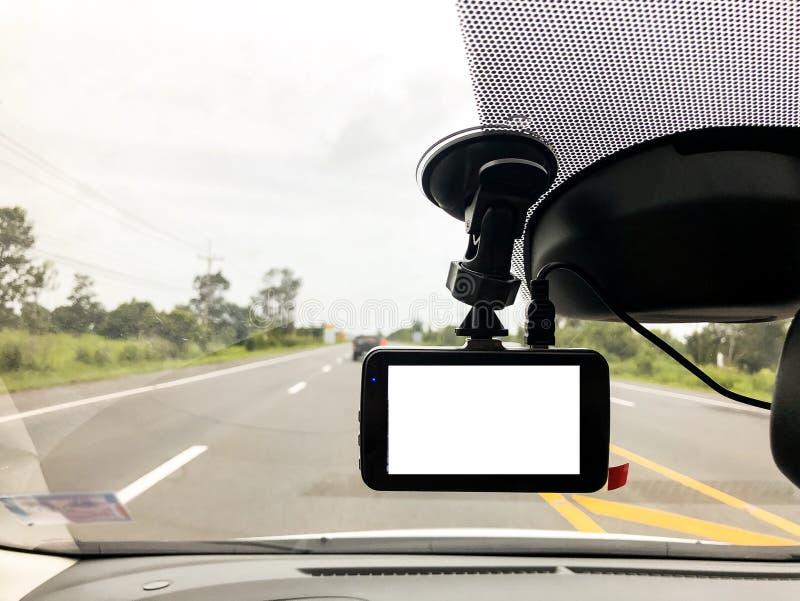 Black digital dashcam camera installed in the car near the rear royalty free stock photos
