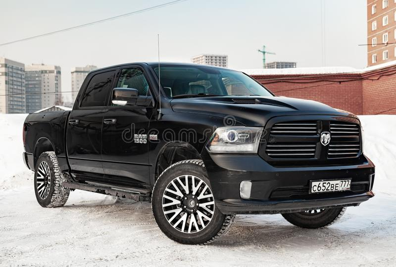 Black Dodge Ram with an engine of 5.7 liters front view on the car parking with snow background stock images