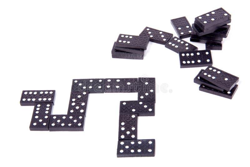 Black domino stones stock image