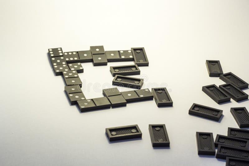 Black dominoes stock photo