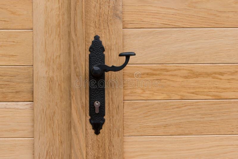 Black door handle, wooden doors stock photography