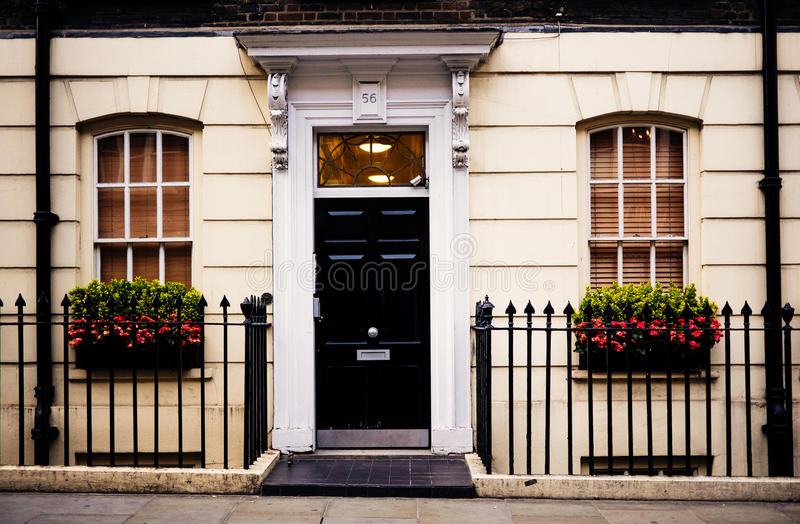 Black Door In White And Beige Building With Black Metal Fence Free Public Domain Cc0 Image