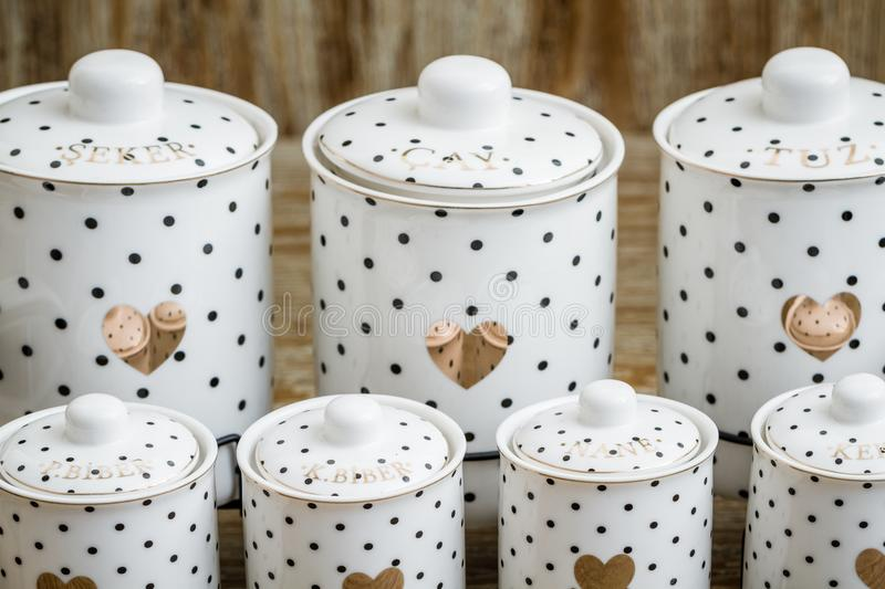 Black Dotted White Porcelain Spice Jars with Heart Pattern stock photography