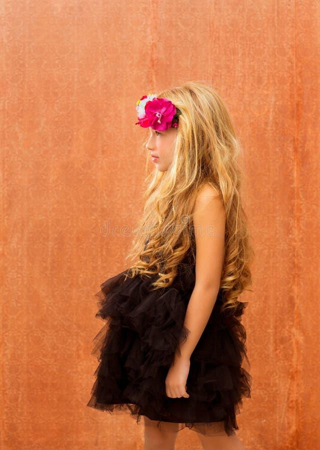 Black dress kid girl profile on vintage background royalty free stock image