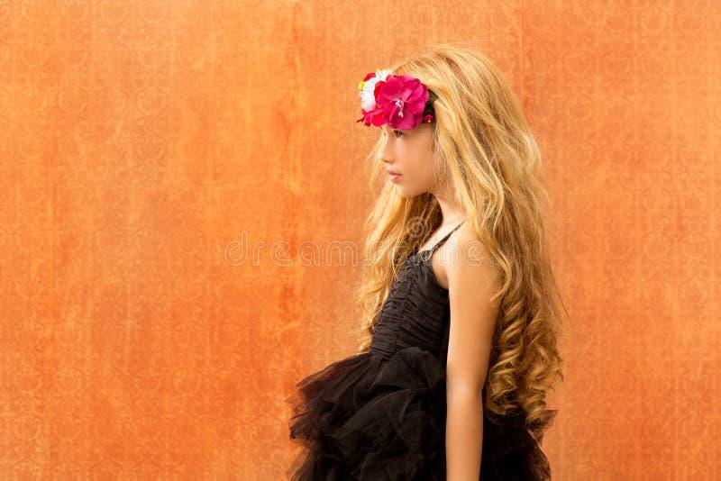 Black dress kid girl profile on vintage background royalty free stock photo