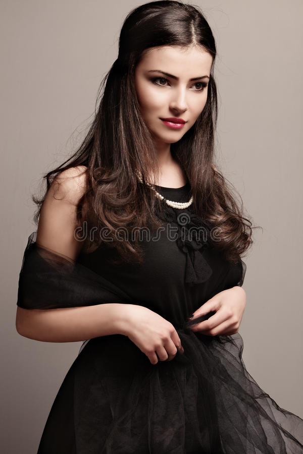 Black dress and pearls royalty free stock photography