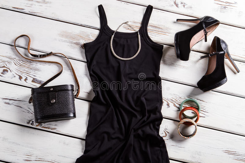 Black dress and small necklace. royalty free stock images