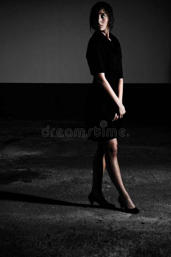 Black Dress Standing In Shadow Royalty Free Stock Photo