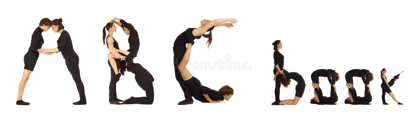 Black dressed people forming ABC book word stock photos