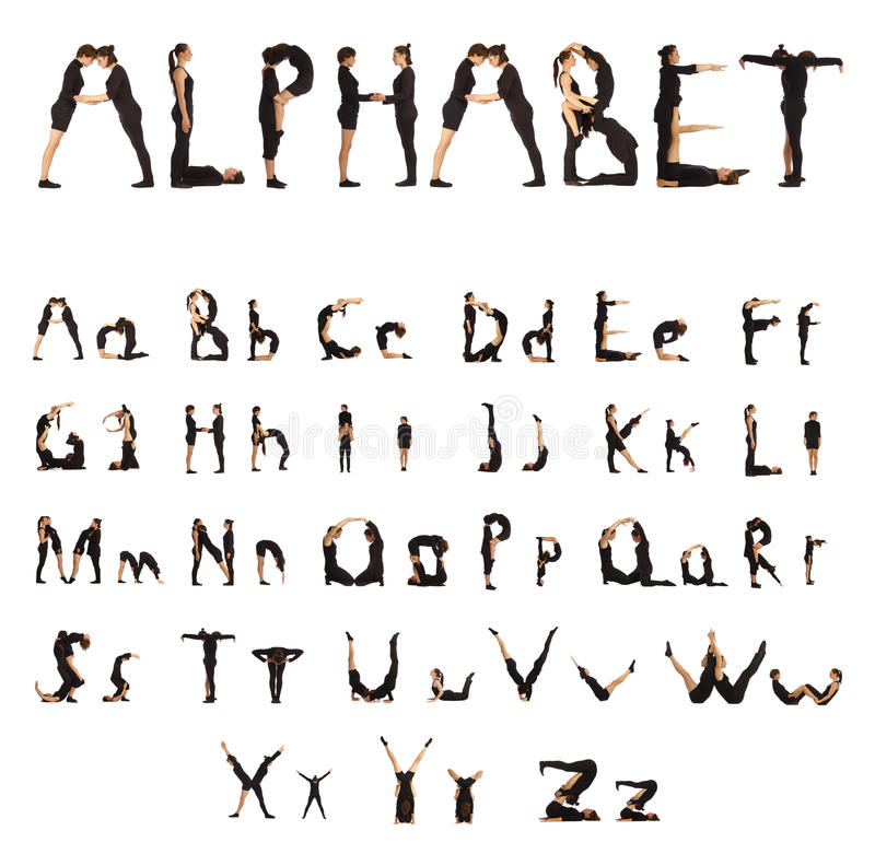 Black dressed people forming Alphabet People stock photography