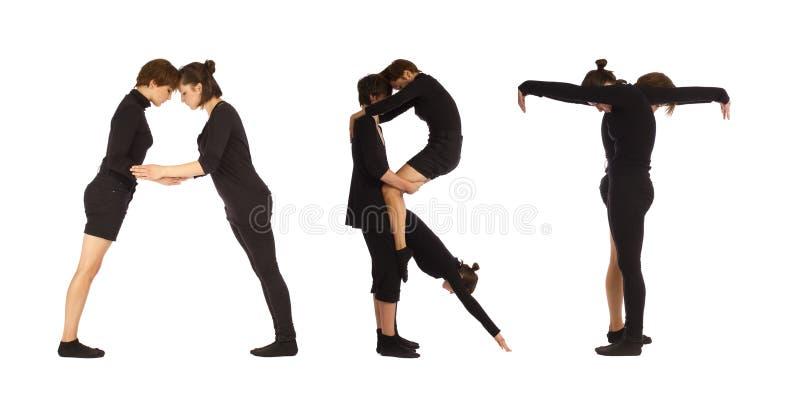 Black dressed people forming ART word stock photo