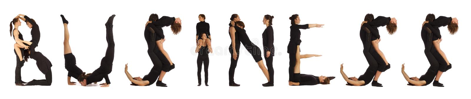 Black dressed people forming BUSINESS word stock photos