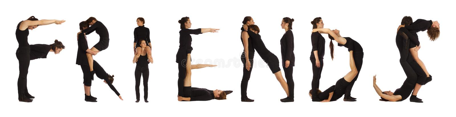 Black dressed people forming FRIENDS word royalty free stock images