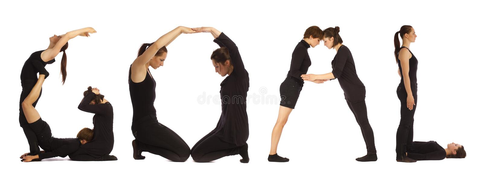 Black dressed people forming GOAL word. Over white background stock photo