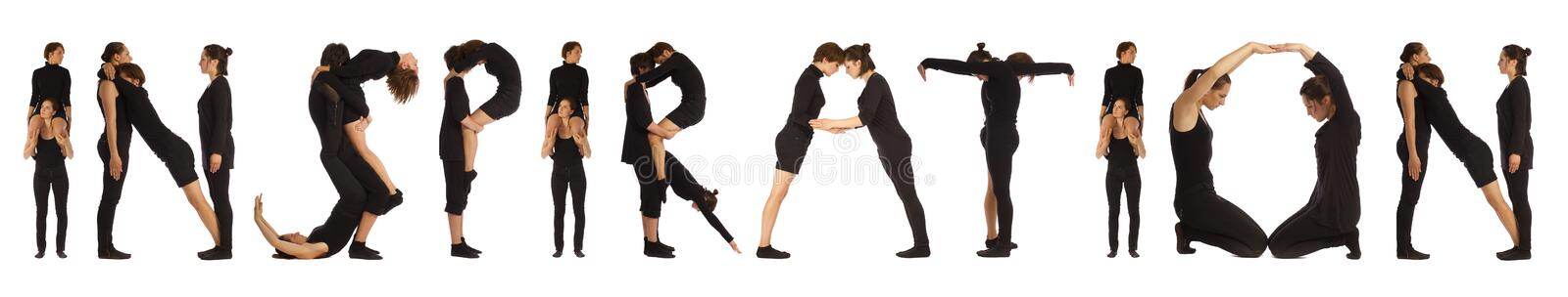 Black dressed people forming INSPIRATION word. Over white background stock photo