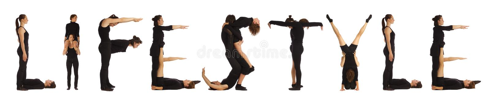 Black dressed people forming LIFESTYLE word. Over white background royalty free stock photography