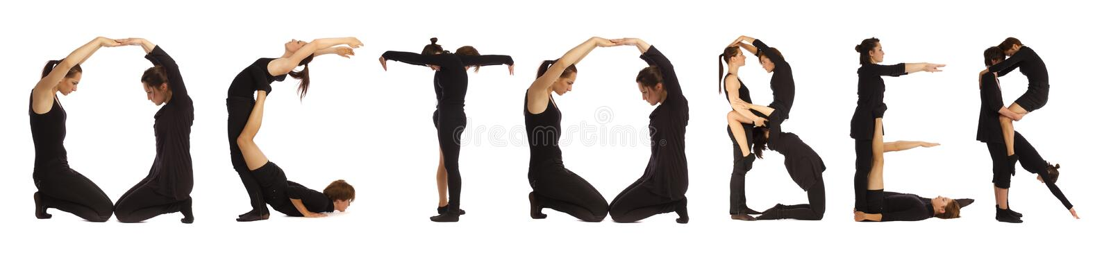 Black dressed people forming OCTOBER word. Over white background stock images